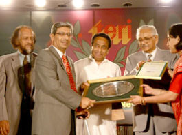 Dr H K Gardin receiving award